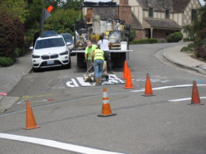 """Painting """"STOP"""" for new crosswalk"""